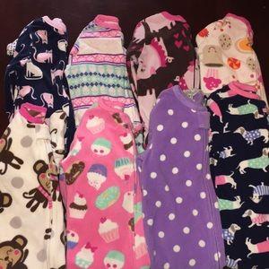 Baby girl bundle of fleece footie jammies.
